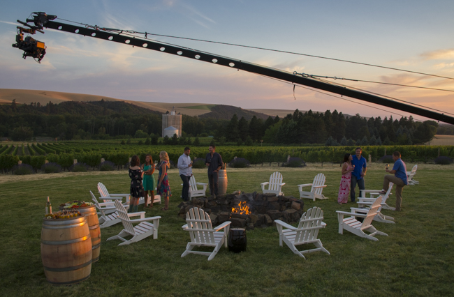 Touring couple meets the winemaker & friends for outdoor wine event at Figgins Family Vineyard, Walla Walla
