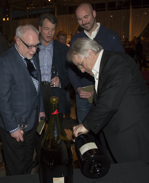 Cole Danehower watching Harry Peterson-Nedtry of Chehalem wines open a large format bottle of vintage at the Willamette Valley wineries 50th Anniversary celebration, Portland, Oregon - Cole I know you'd have the perfect caption for this ending photo.....