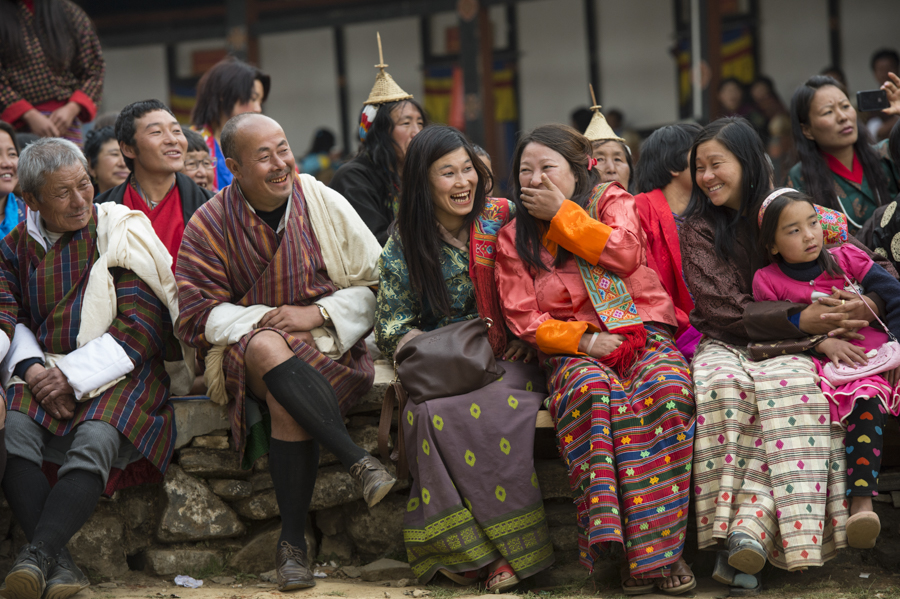Gasa Tschu festival audience laughing at masked clown antics, Bhutan