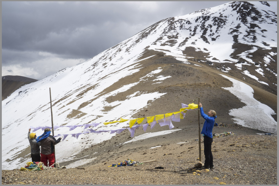 At the 16,000 foot Nyilela Pass pass our Tibetan camp boy, a past monk, helped me hang our prayer flags - two for the deceased, one for my good luck year of iron (white), and one for Mark & Kelly Shafer (yellow)