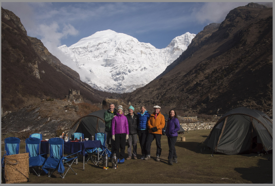 Our base camp at Jomolhari Base Camp - Left to right:  Mark & Kelly Shager, Bob Holmes, Andrea Johnson, Robert 'Skp' Sandber, Amanda Mason.  Mani wall with prayer flags & old fortress shadowed by the massive 24,000 foot Himalayan peak