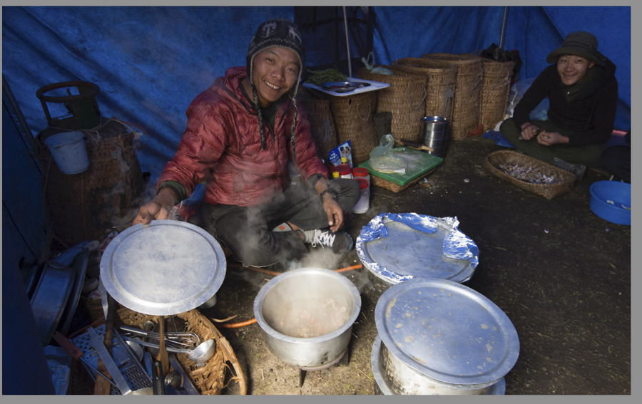 Our incredibly talented cook at work preparing dinner- the meals were some of the best we had in Bhutan: a full spice rack and baskets in background filled with 9 chickens, fresh vegetables and fruit for entire week, and even surprise treats such as apple pie & chocolate bundt cake