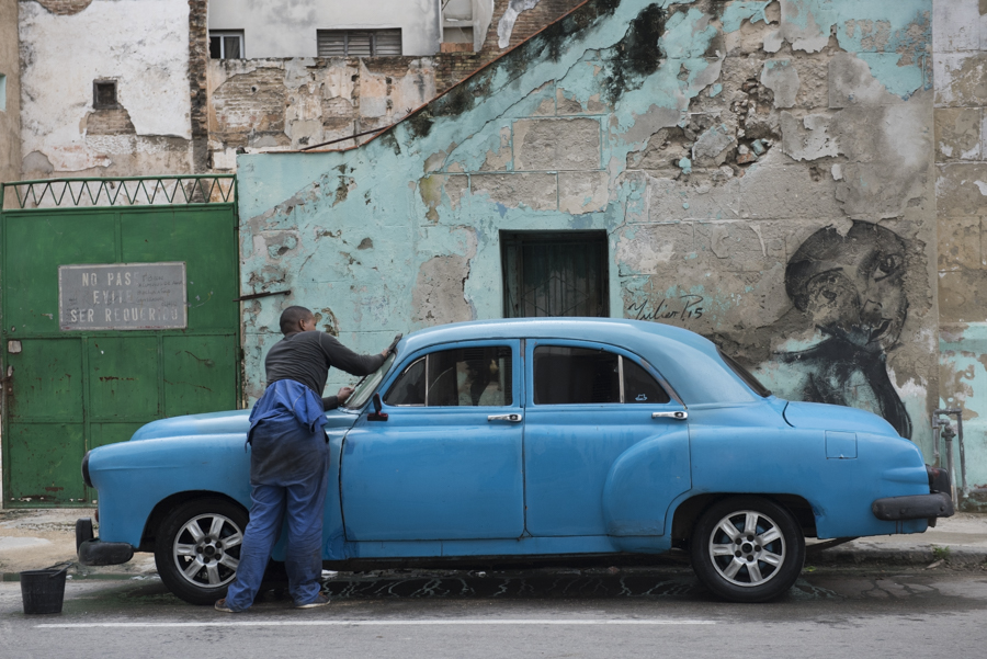 Washing the car in a backstreet of old Havana