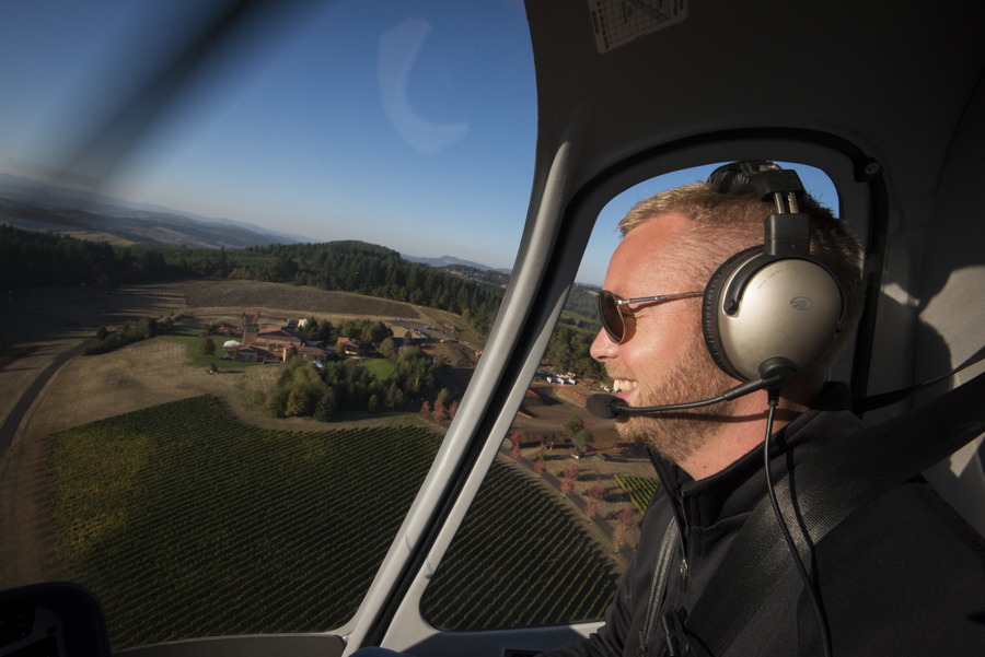 Tyler Sturdevant, pilot and owner of Precision Helicopter, flying over Oregon vineyards.