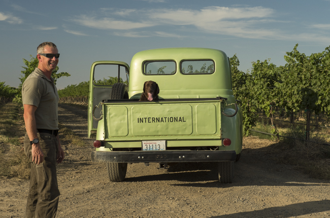 Rob Mercer, his dog, and vintage truck 'green' preparing for driving scenes